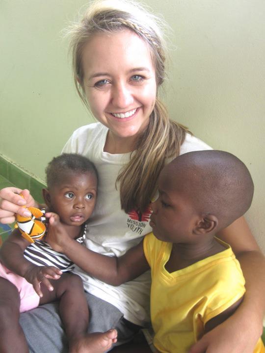 Scott with children in Haiti